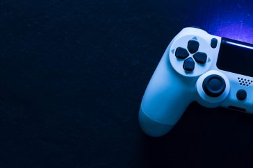 Video game gaming controller night with lights dark background top view